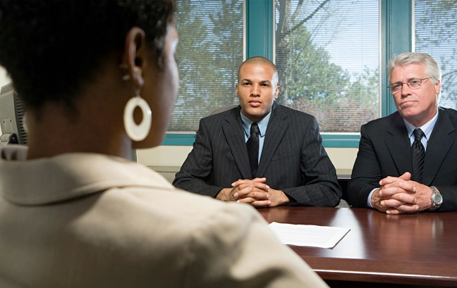 African American woman at job interview with two men