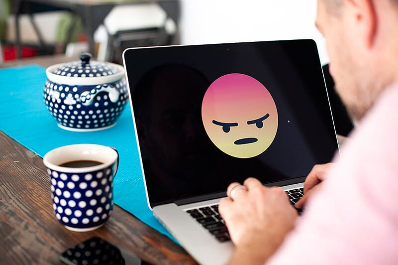 angry face on laptop