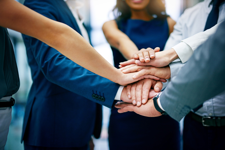 business people hands in circle