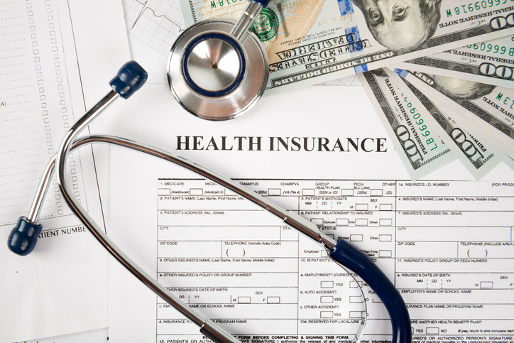 health insurance form with money