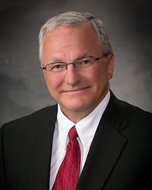 John E. Van Tholen