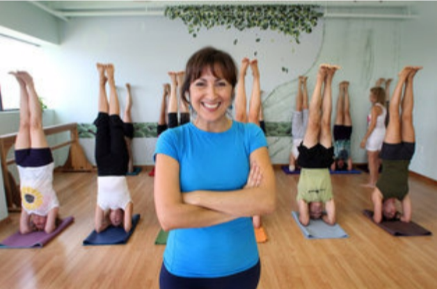 Yoga teacher stretches to build healthy business