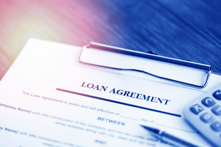 small business owner signing a loan agreement