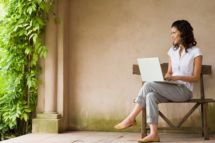 woman with laptop outside