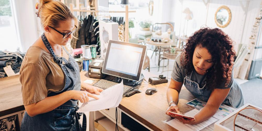 two women working together in a store