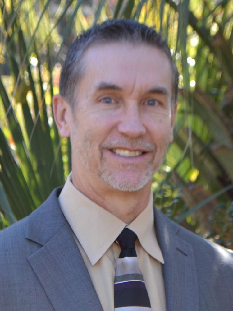 Trevor T Crunelle