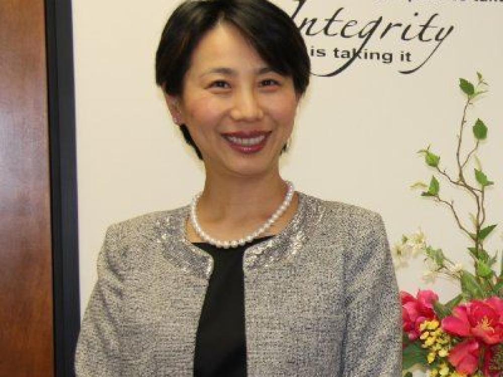 Mandy Min Woo, CFP, M.S.T.