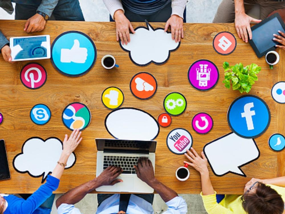 meeting table with social media icons spread out