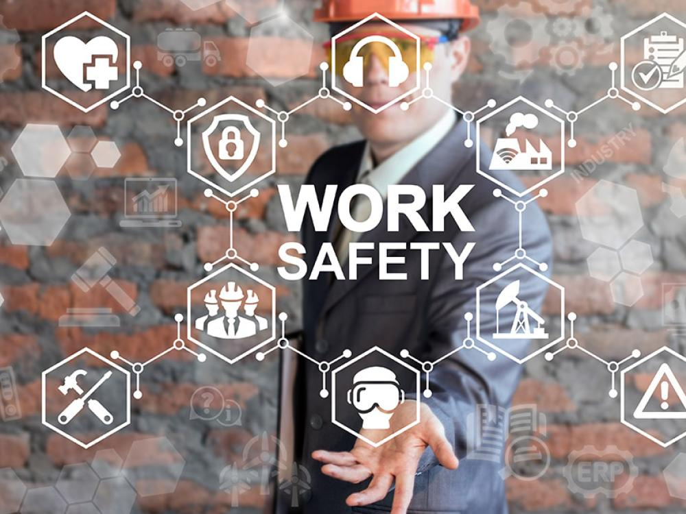 man in hard hat holding safety icons