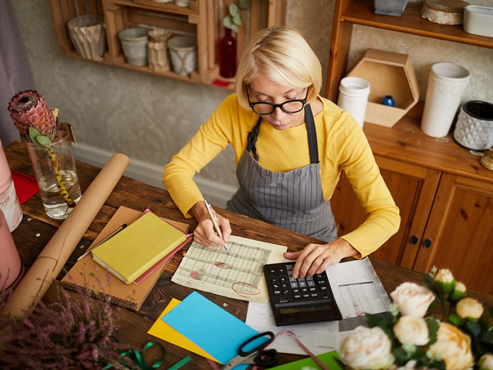 business owner florist calculating pricing