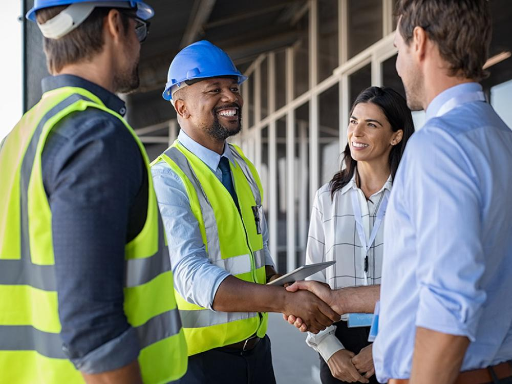 Contractor and Businessman handshake on construction site