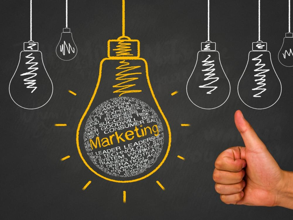 marketing written in chalk inside light bulb