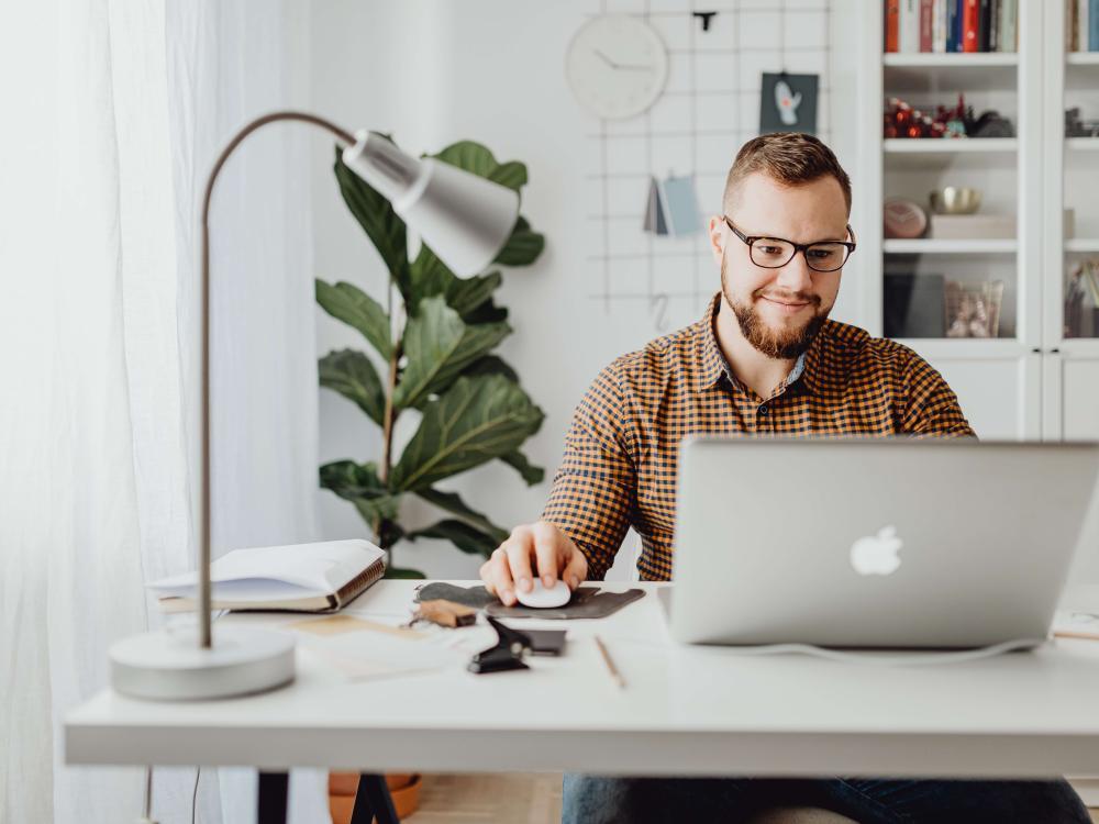 Happy guy at computer
