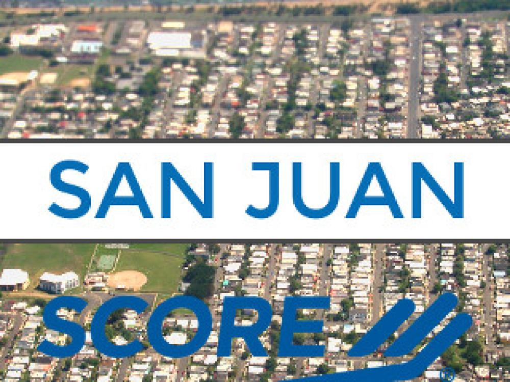 SYB Podcast Episode #65 Featured Image: Small Business in Puerto Rico Refuse To Give Up | San Juan Metro SCORE Logo over Aerial Photo of Island