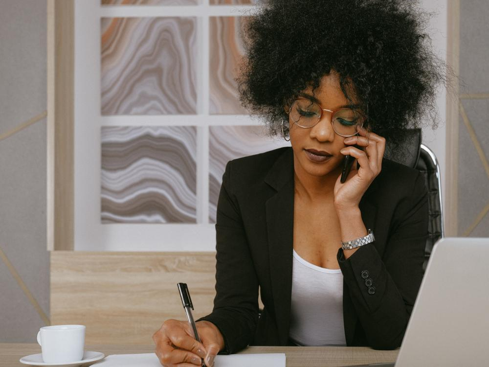 minority-business-owner-on-phone