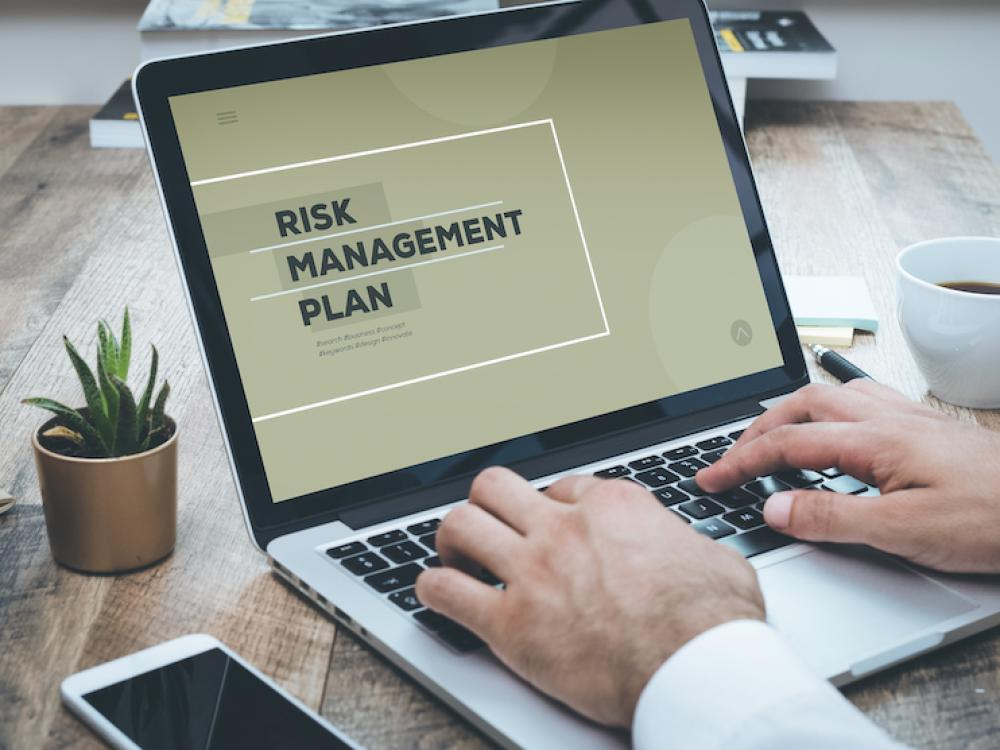 laptop with risk management plan on screen