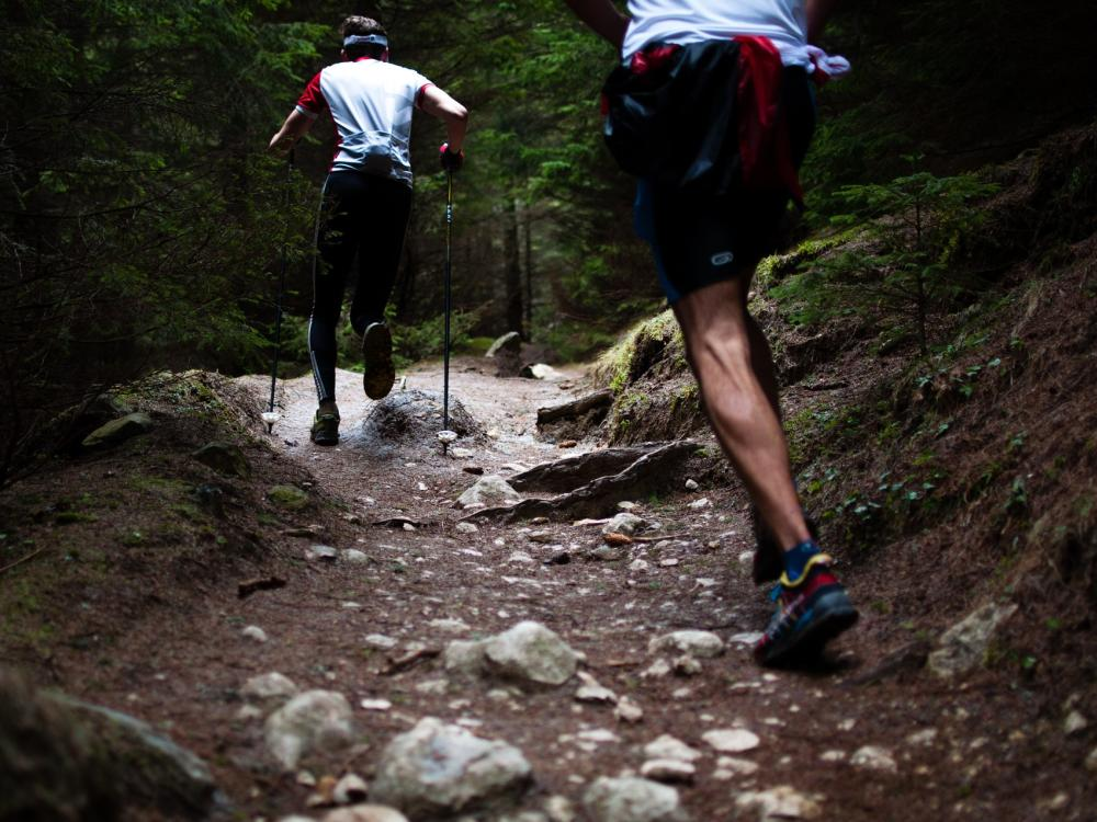 business professionals taking care of themselves by hiking