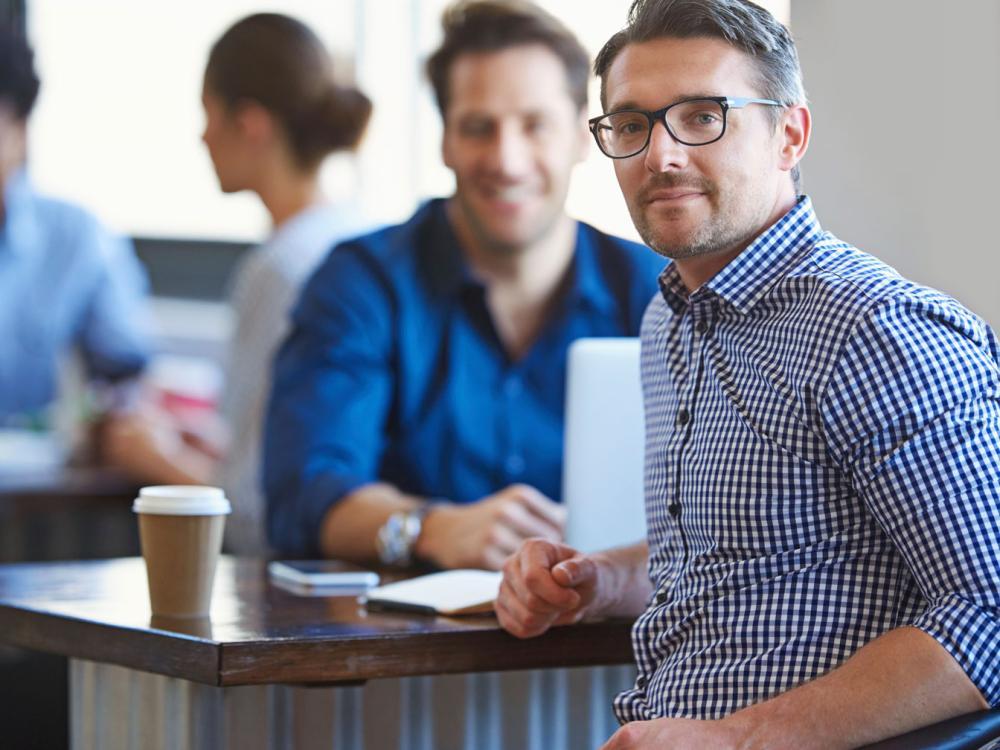 Man meeting with customer over coffee