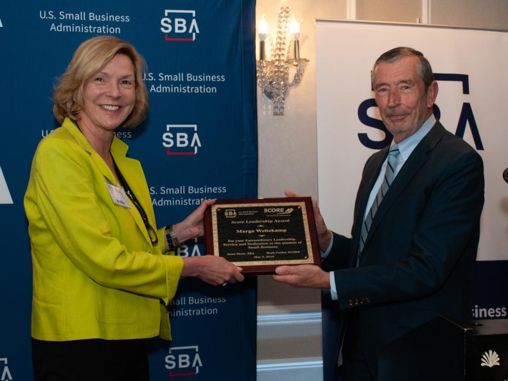 Margo Weitekamp, Chair of the Southeast CT chapter of SCORE, receives from Brian Baxendale, Assistant Regional Director SCORE, the 2017 Connecticut Leadership Award at this year's annual SBA Small Business Week ceremony in New Haven, CT.