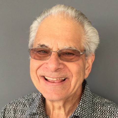 Eric M Solomon