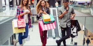 3 shoppers using smartphones