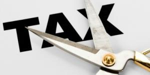 """Scissors cutting the word, """"Tax""""."""