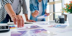 Advertising designer creative start-up team discussing ideas in office