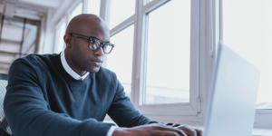 African-American businessman on laptop
