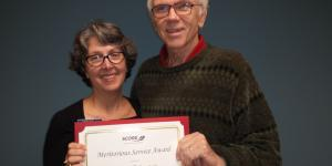 Kathy Pearce (left), President of Charlotte SCORE presents the Meritorious Service Award to David (Dave) Center of Concord, NC.