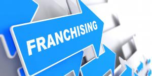 Illustration of arrows with the word 'Franchising' on one.