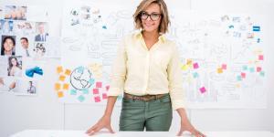 female entrepreneur planning on whiteboard