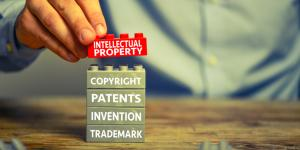 Stacked Lego's that read Intellectual Property, Copyright, Patents, Invention, Trademark