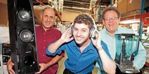 Chad Kalecky wears headphones, Dan Kalecky holds a speaker and Steve Weiss holds a blender at Kalektronics in Sunrise. It buys and refurbishes electronics and other goods to resell.