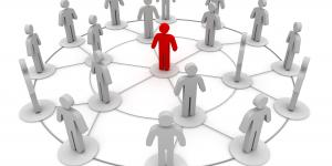 Photo of stick figures in a connecting circle, indicating networking
