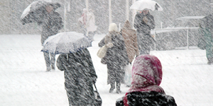 people walking in snowstorm