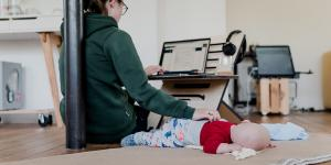 Woman working from home with child