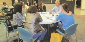 SCORE volunteer counselor Steve Baune leads a roundtable discussion during the organization's signature annual event last October. More than 100 small business owners attended, participating in workshops, learning from a panel of volunteer small business experts and more.