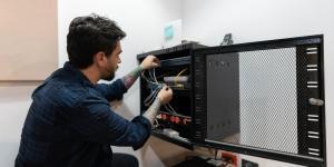 man working on computer server