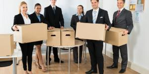 business people holding boxes
