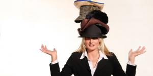 business woman wearing multiple hats