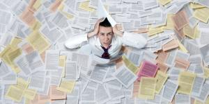 business flooded with paperwork