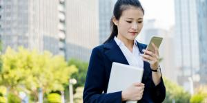 business woman uses smartphone