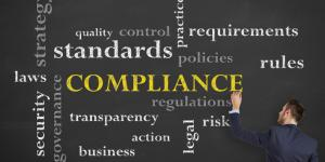 compliance regulations rules policies on chalkboard