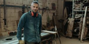 man standing in carpentry shop
