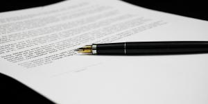 Photo of a contract and pen