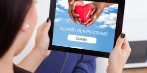 woman donating to charity on tablet
