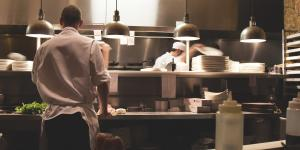 Photo of an active commercial kitchen