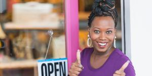 woman in front of open business