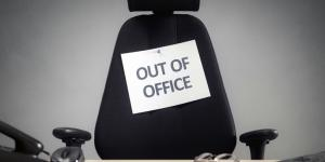 out of office sign on chair