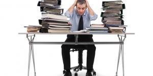 overwhelmed businessman at a messy desk